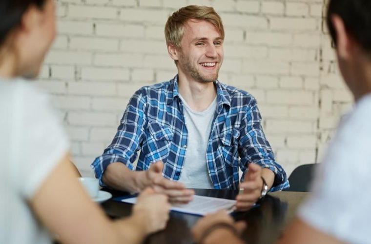 Young man smiling in job interview
